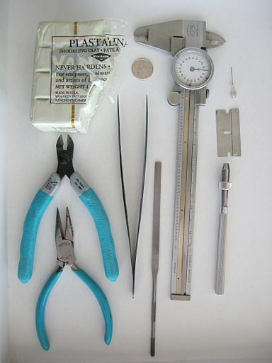 Tools used for fitting pin-caps to briolettes.